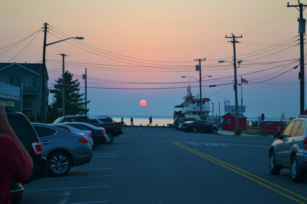 sunset over the bay looking down a street