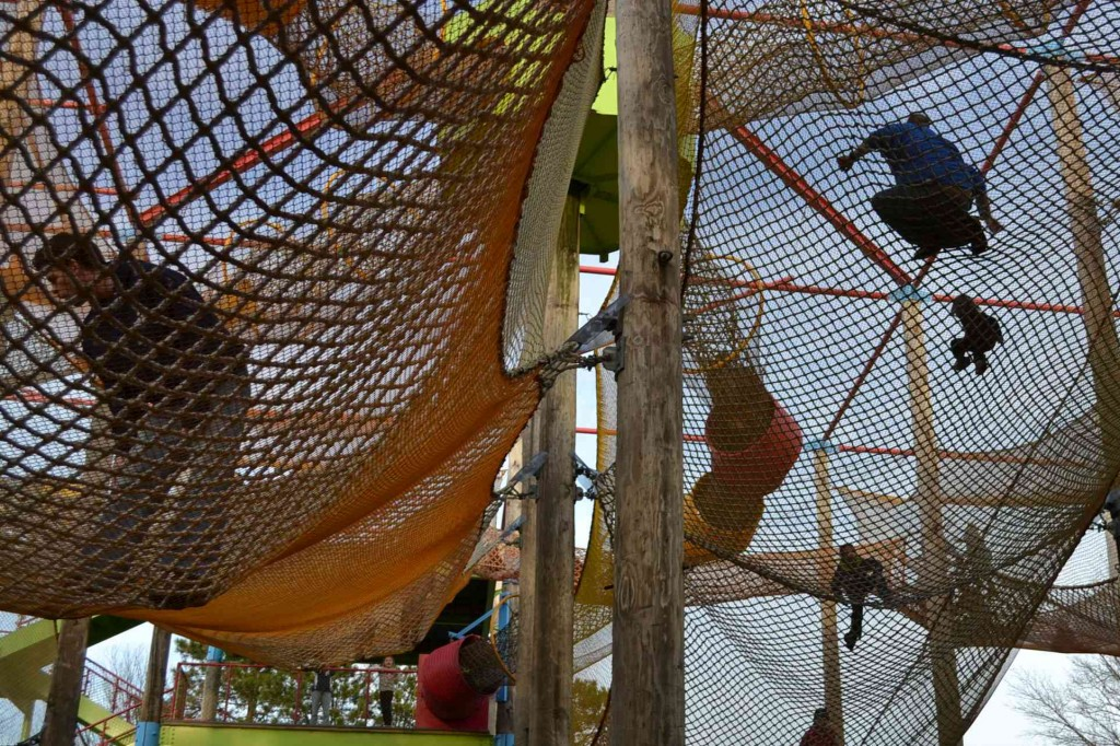 kids in a climbing net