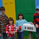 kids near big birds house
