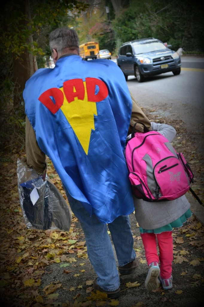dad in a dad superhero cape