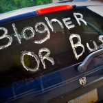 a car with blogher or bust written on bac