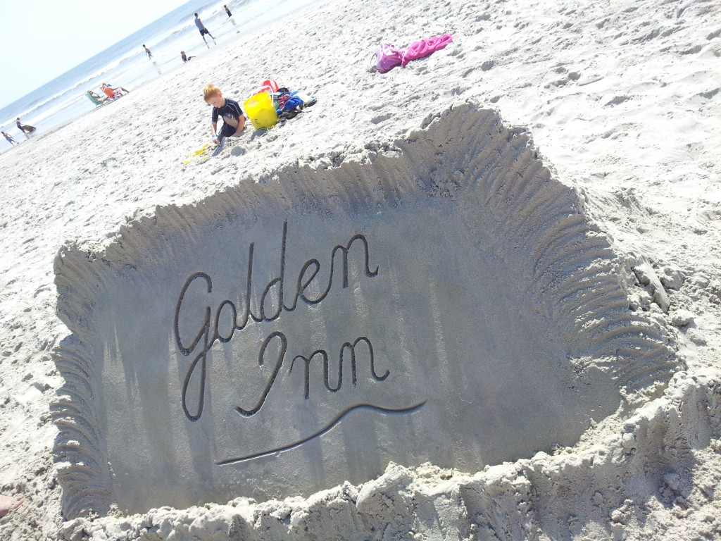 golden logo out of sand