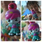 girl holding an out of this world doll
