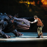 guy on stage with dragon