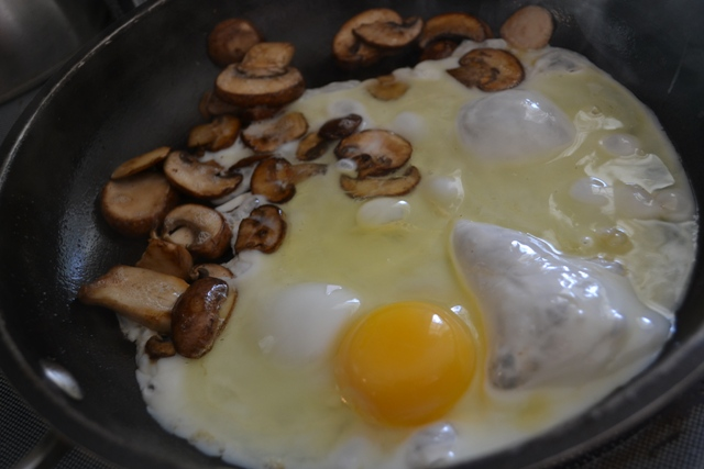 mushrooms cooking with eggs