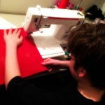 boy sewing