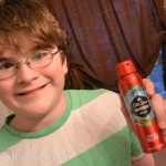 boy with old spice spray